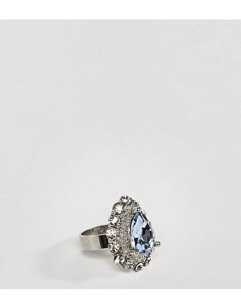 2e3ad0b8ff0d Anillo de estilo vintage plateado con cristal y piedra en azul claro design  curve